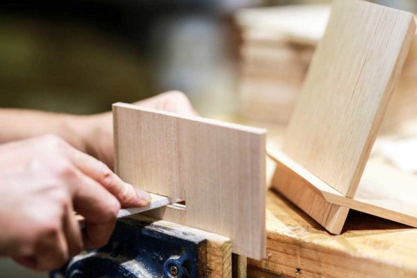 Handmade wooden photo frame in production